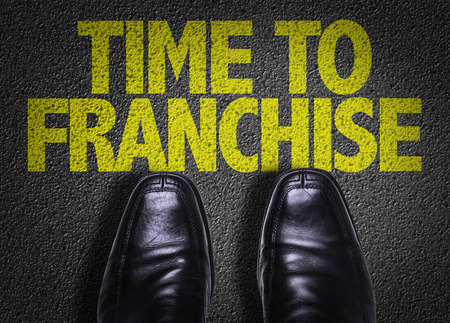concession: Text on road with business shoes background: Time to franchise Stock Photo