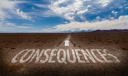 Consequences written on desert background Standard-Bild