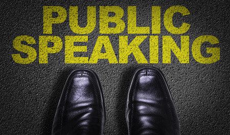 extrovert: Text on road with business shoes background: Public speaking