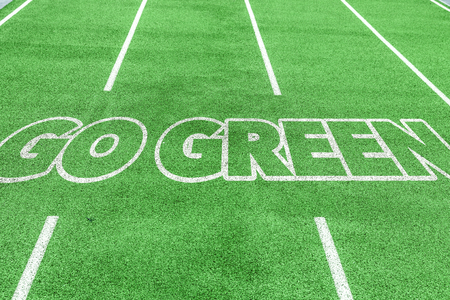 go green background: Go green written on field background Stock Photo