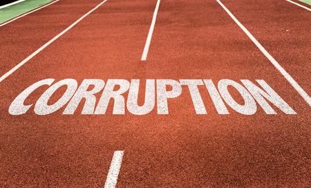 misconduct: Corruption written on running track background Stock Photo