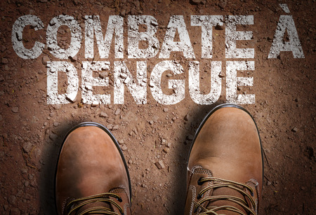 Text on road with boots background: Combate a dengue (defend against dengue in Portuguese)