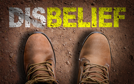 jesus word: Text on road with boots background: Belief