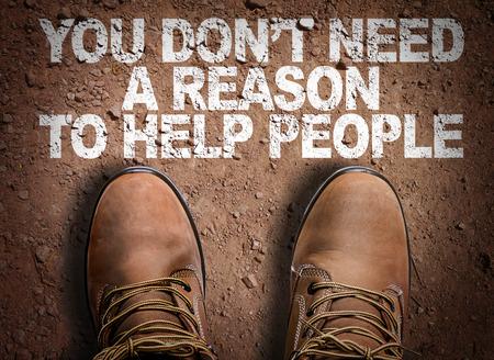 부츠가있는 도로의 텍스트 배경 : 사람들을 도울 이유가 필요 없습니다.