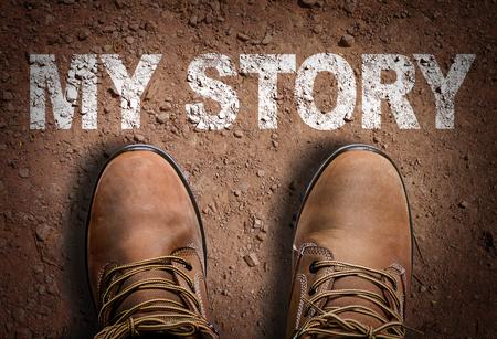 Text on road with boots background: My story Zdjęcie Seryjne