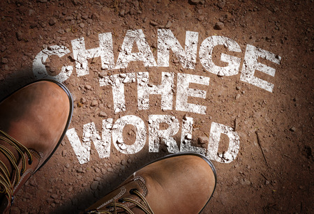 life change: Text on road with boots background: Change the world