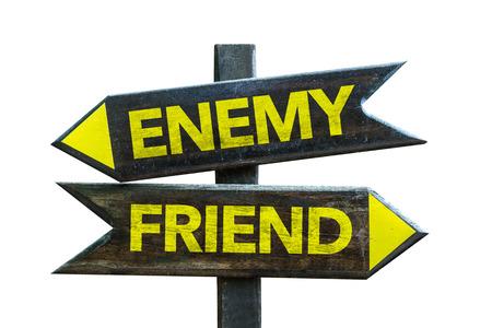 untrustworthy: EnemyFriend sign with arrow on white background Stock Photo