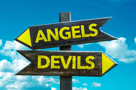 Text sign with arrow on clouds and sky background: AngelsDevils Stock Photo