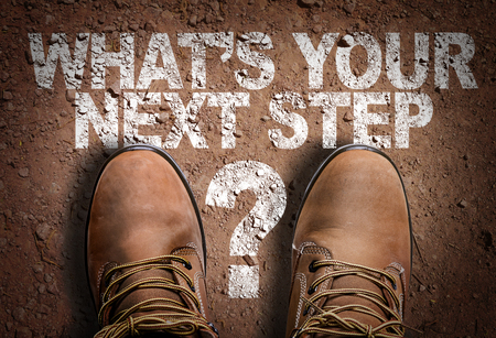 Text on road with boots background: What's your next step? 版權商用圖片 - 65025831