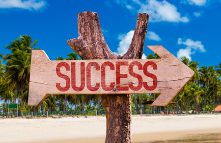 Success sign with arrow on beach background