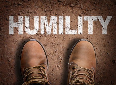 humility: Text on road with boots background: Humility