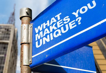 distinct: What makes you unique? signpost on building background