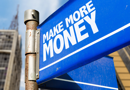 Make more money signpost on building background Stock Photo