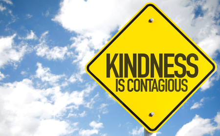 helpfulness: Kindness is contagious sign with clouds and sky background