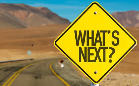 What's next? sign with desert background