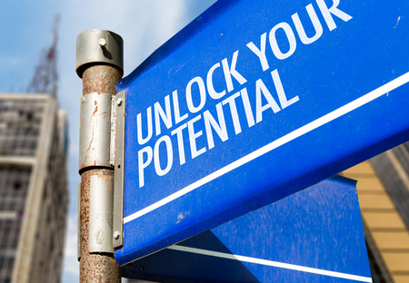 potential: Unlock your potential signpost on building background