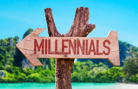 demografia: Wooden sign board in wetland with text: Millennials Foto de archivo
