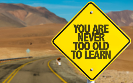 You are never too old to learn sign with desert background Stock Photo