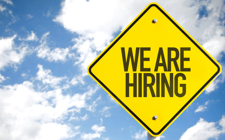 We are hiring sign with clouds and sky background