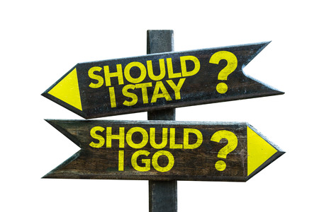 indecisiveness: Should I stay?Should I go? sign with arrow on white background Stock Photo