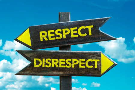 irrespeto: Text sign with arrow on clouds and sky background: Respectdisrespect