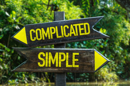 difficult lives: Complicatedsimple sign with wetland background Stock Photo
