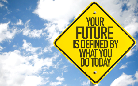Your future is defined by what you do today sign with clouds and sky background Stock Photo