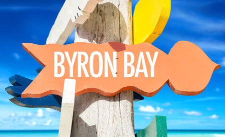 byron: Byron Bay sign with beach background Stock Photo