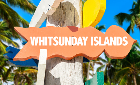 Whitsunday Islands sign with beach background