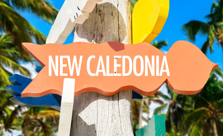 new caledonia: New Caledonia sign with beach background Stock Photo
