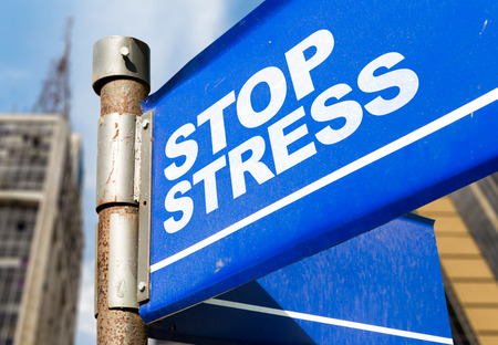Stop stress signpost on building background Stock Photo