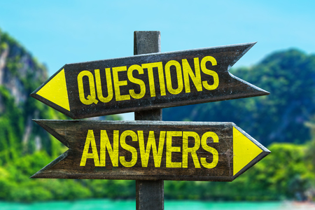 guidance: Questionsanswers wooden sign board in wetland background