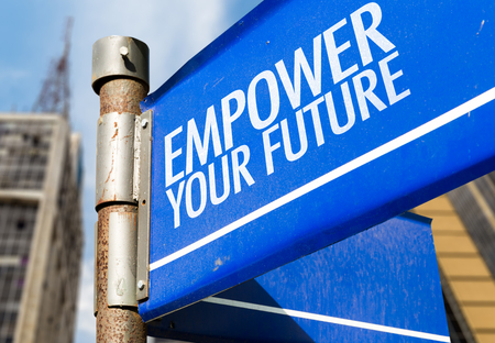 Empower your future signpost on building background Stock Photo