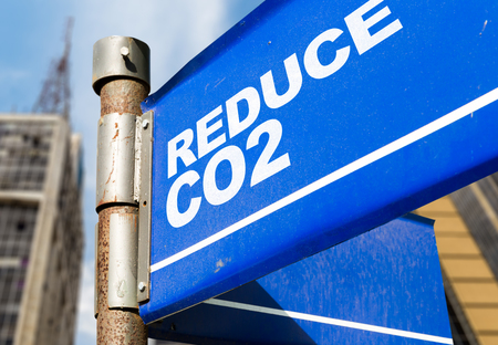 Reduce CO2 signpost on building background