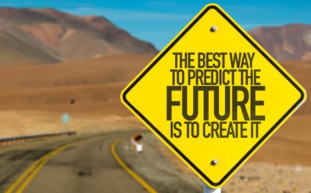 未来を予測する最良の方法は砂漠の背景を持つ記号を作成するのには 写真素材