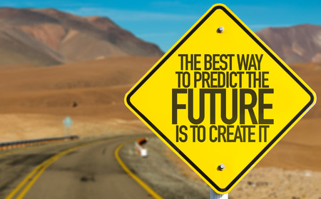 The best way to predict the future is to create it sign with desert background 스톡 콘텐츠