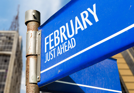building planners: February just ahead signpost on building background Stock Photo