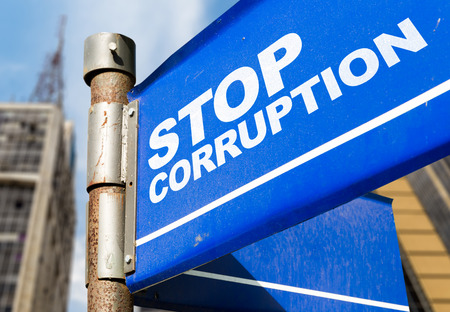 Stop corruption signpost on building background
