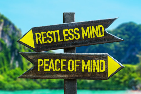Restless mind/peace of mind sign with wetland background Archivio Fotografico