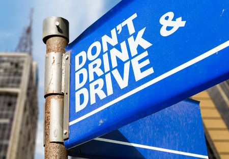 Dont drink & drive signpost on building background