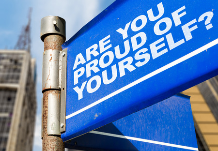 Are you proud of yourself? signpost on building background