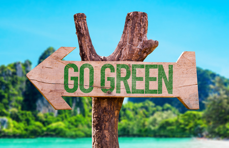 Wooden sign board in wetland with text: Go green Stock Photo