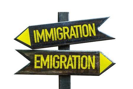 emigranti: Immigrationemigration sign with arrow on white background Archivio Fotografico