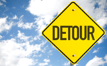 redirect: Detour sign with clouds and sky background
