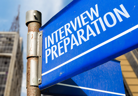 Interview preparation signpost on building background