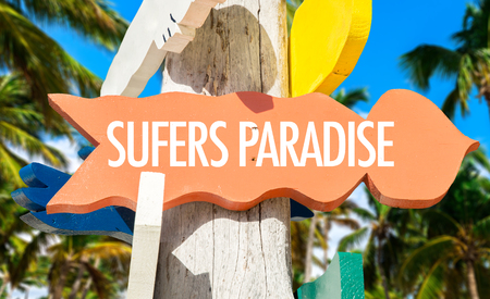 surfers paradise: Surfers Paradise sign with beach background Stock Photo
