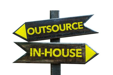 business words: Outsourcein-house sign with arrow on white background Stock Photo