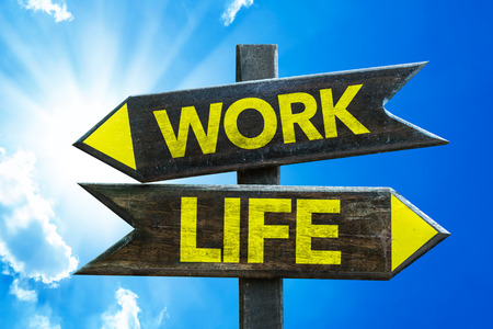 Worklife sign with arrow on sunny background