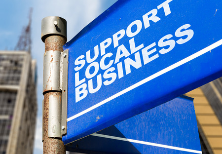 local business: Support local business signpost on building background