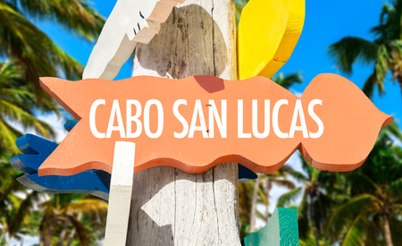 lucas: Cabo San Lucas sign with beach background